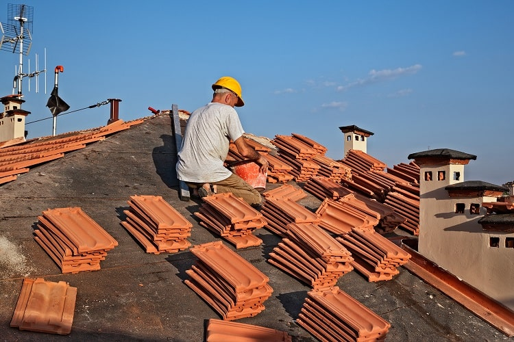 Construction-Worker-On-A-Roof-While-Roof-Replacing